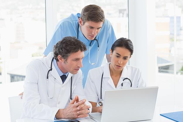 Team of doctors working on laptop computer in medical office.jpeg